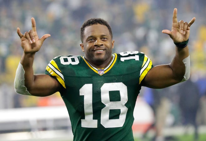 Green Bay Packers wide receiver Randall Cobb is all smiles as fans cheer his name as he leaves the field following a victory against the Pittsburgh Steelers Oct. 3 at Lambeau Field.