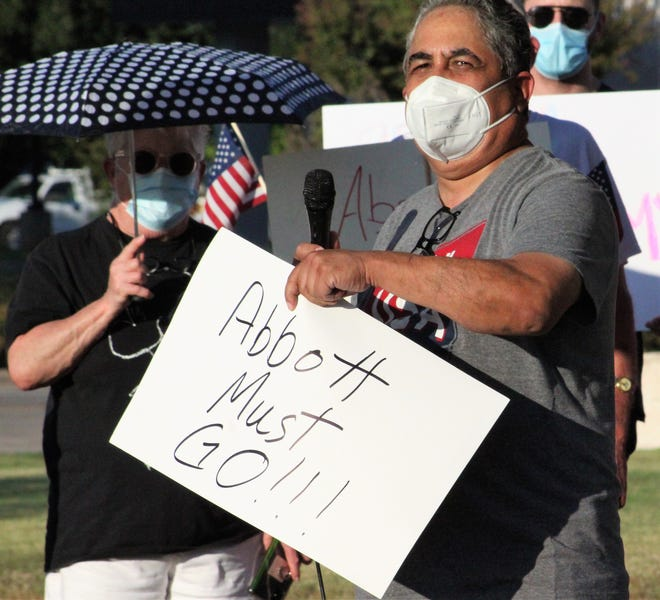 Former Abilene ISD board member Samuel Garcia led off Monday's protest against Gov. Greg Abbott at City Hall by attacking the governor's health mandates affecting school districts across the state. Those participating in the protest wore face masks.