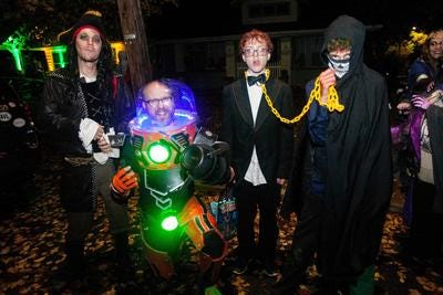 Trick-or-treaters braved the rain and wind to visit the houses on Vermont Avenue in West Asheville for candy on Halloween Oct. 31, 2019.