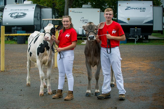 Addison and Grant Lahmers are siblings from West Lafayette who showed dairy cattle Monday at the Coshocton County Fair.