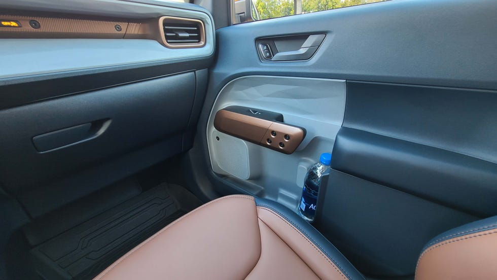 The 2022 Ford Maverick features a cleverly-designed door that is scalloped to handle even oversized bottle.