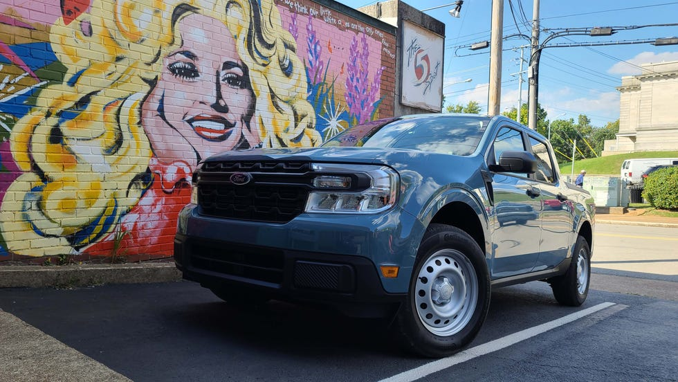 Dolly Parton smiles on the affordable, hip 2022 Ford Maverick in Nashville.