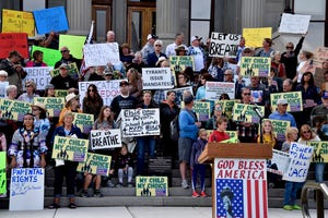 People gather to protest mask requirements in schools in front of the state capitol in Helena, Mont., on Oct. 1. A district judge in Missoula has denied a request by several parents to halt mask mandates in Missoula schools while a legal challenge of the mandates is underway.