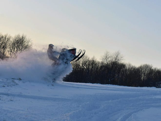A member of the Iowa Snowdrifters, a snowmobile club operating in the Iowa City and Cedar Rapids aream is seen here riding a snowmobile. The club has maintained trails that run through North Liberty, but the city wants to halt all snowmobile traffic due to population growth.