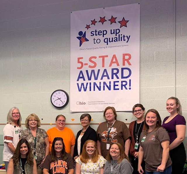 Madison Preschool staff celebrate the renewal of their Step Up to Quality five-star rating.