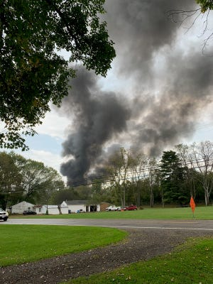 Smoke bellows from a commercial fire reported on Marne Road on Monday Oct. 4, 2021.