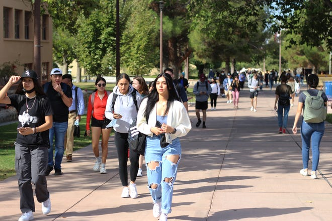 Students at New Mexico State University walk between their classes on Monday, Oct. 4, 2021.