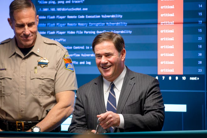 Gov. Doug Ducey smiles just before the ribbon-cutting at the Arizona Counter Terrorism Information Center in Phoenix on Oct. 4, 2021.