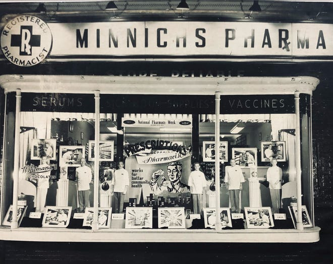 Photograph of the Minnich's Pharmacy at 501 W. Market St. features the cardboard cutout of six pharmacists who worked at the store, four of whom went on to open their own pharmacies.