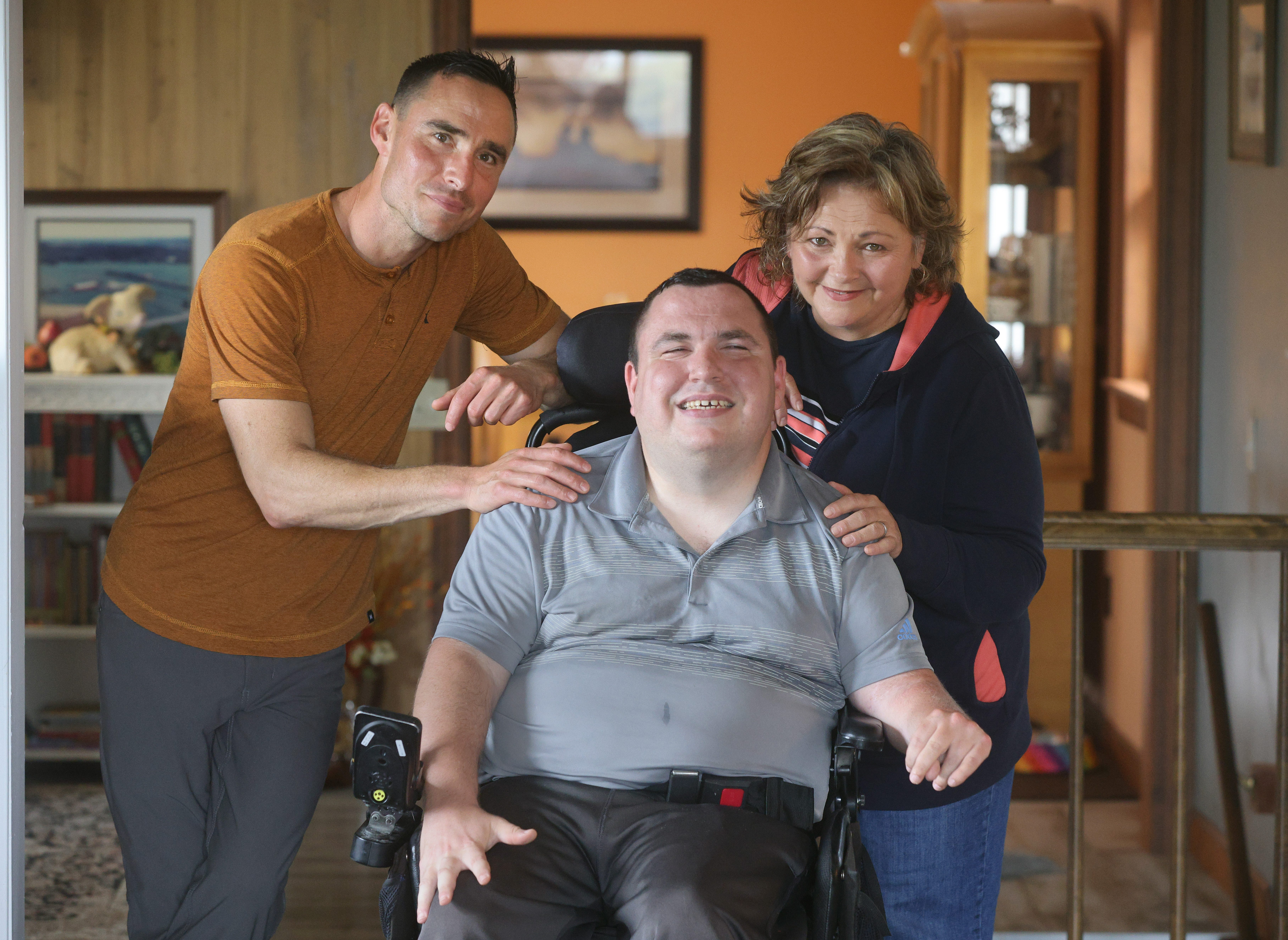 Joe Slomba has cerebral palsy and lives at home with his family. His mother Nancy and twin brother Ben split time as his paid caregivers but Medicaid only allows for $12.50 an hour for that care. Jamie Germando/Rochester Democrat & Chronicle