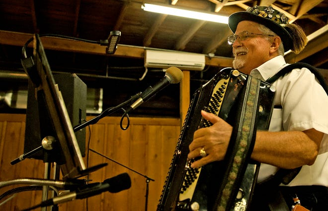 Dennis Koehler warms up on the accordion prior to the start of the Oktoberfest event at the Ft. Concho Stables on Friday, Oct. 1, 2021.