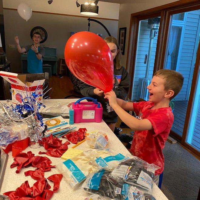 Rachel's homegrown balloon-blowing crew: Eli, Arianna, and Wyatt.