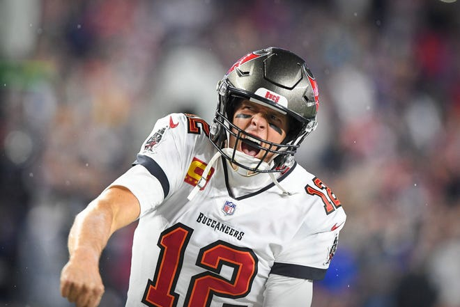 Tampa Bay Buccaneers quarterback Tom Brady (12) yells to the crowd as he takes the field to face his the New England Patriots at Gillette Stadium.