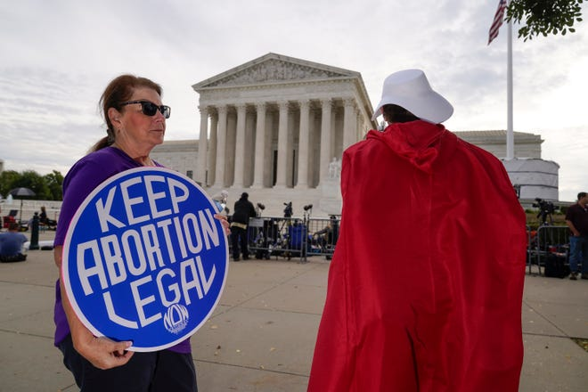 The Supreme Court is seen on the first day of the new term as activists demonstrate on the plaza, in Washington, Monday, Oct. 4, 2021. Arguments are planned for December challenging Roe v. Wade and Planned Parenthood v. Casey, the Supreme Court's major decisions over the last half-century that guarantee a woman's right to an abortion nationwide. (AP Photo/J. Scott Applewhite) ORG XMIT: DCSA109