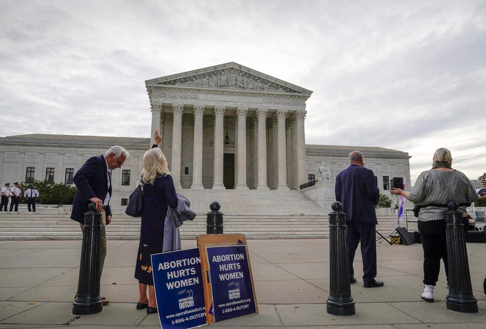 Anti-abortion activists demonstrate outside the Supreme Court on Oct. 4. Arguments are planned for December challenging Roe v. Wade and Planned Parenthood v. Casey, Supreme Court decisions that guarantee a woman's right to an abortion nationwide.