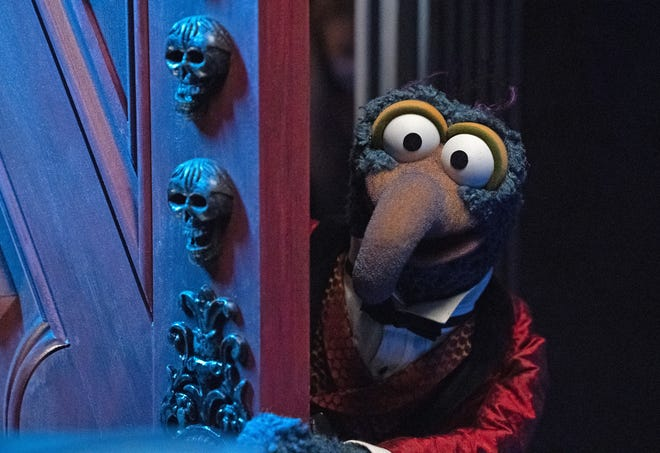 """Gonzo lives in a night surrounded by 999 Spooks and Specters in """"The Muppets Haunted Mansion."""""""