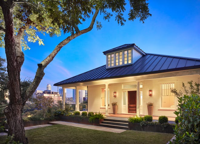 This Castle Hill home by LaRue Architects is part of the AIA Austin Homes Tour. The original 1915 home has been redone and looks similar from the front. Around the side is the modern view of the house.
