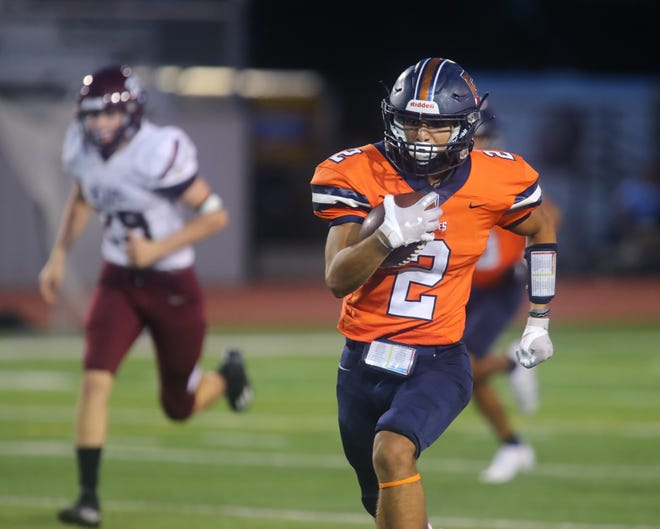 Glenn's Joshua Contreras races 58 yards for a Glenn touchdown against Bastrop Sept. 30 at Bible Stadium. Contreras racked up 177 yards on 16 carries as the Grizzlies' slot-t offense controlled the line of scrimmage and the clock on the way to a 34-10 win.