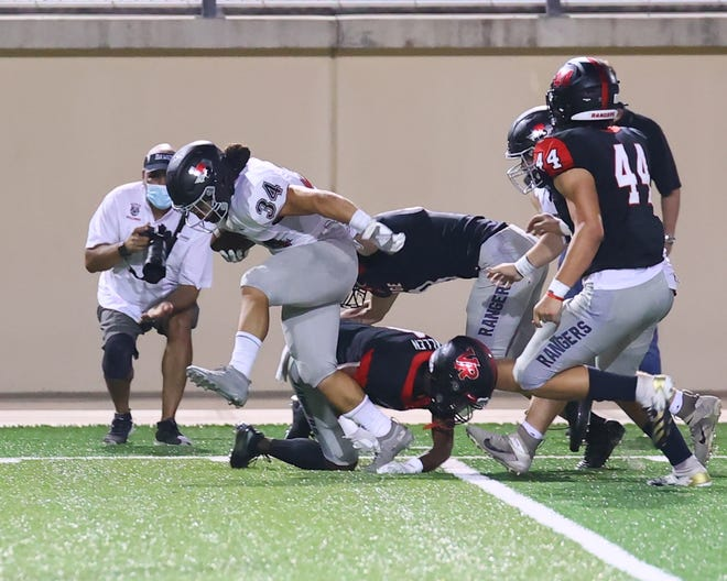 Bowie running back Noah Camacho, rumbling over Vista Ridge defenders in the first game of the season, and the unbeaten Bulldogs hope to knock off No. 1 Westlake Friday at Chaparral Stadium.