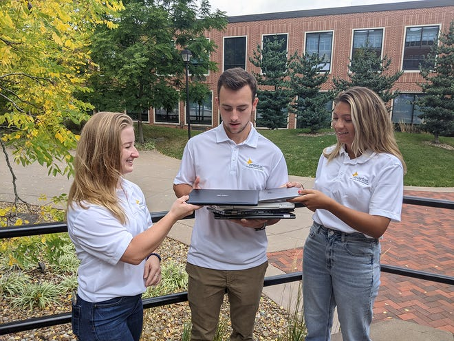 UMU Enactus chapter officers, from left, Grace Bjordahl, Conner Kenosh and Mackenzie Cavalier prepare for the 2ndLifeLaptopdonation/collection event on Oct.18.