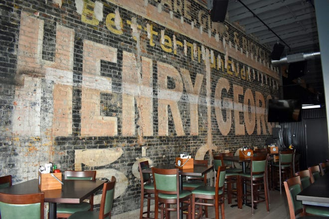 A mural on the east wall of Sweet Caroline's Kitchen & Cocktails features a historic advertisement for Henry George cigars. The exposed wall was the exterior of the building at 314 Main St. when the ad was painted. It was the business of gunsmith and machinist George Roberson. There was no building where Sweet Caroline's is located, 316 Main, at the time the advertisement was painted.