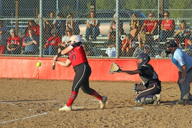 Dawsyn Lightner, one of four 2021 Chillicothe High School softball Lady Hornets playing in their final regular-season home game, delivers a game-ending 2-runs double to right-center field in the bottom of the fifth inning of Monday's 10-0 victory over St. Joseph: Bishop LeBlond.