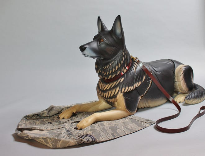 """""""Robson"""" is one of the life-size wood sculptures made by artist Jim Mellick as part of the Wounded Warrior Dogs exhibition scheduled Oct. 20-24 at the National Veterans Memorial and Museum, 300 W. Broad St. in Columbus. Robson, a German shepherd, served the U.S. Air Force for six years as a patrol and explosives-detection dog."""