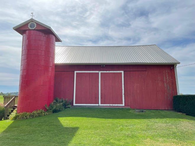 Once the scraping and prep work is done, a fresh coat of bright-red paint will freshen up the barn.