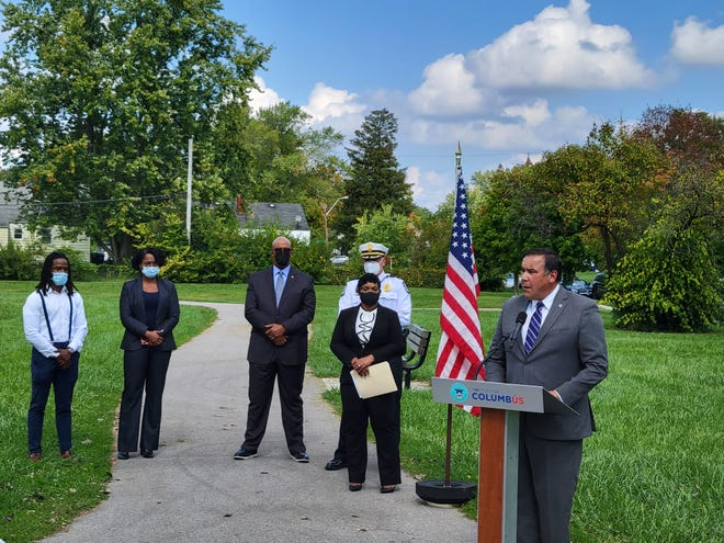 Columbus Mayor Andrew J. Ginther speaks at a news conference in Audubon Park in North Linden.
