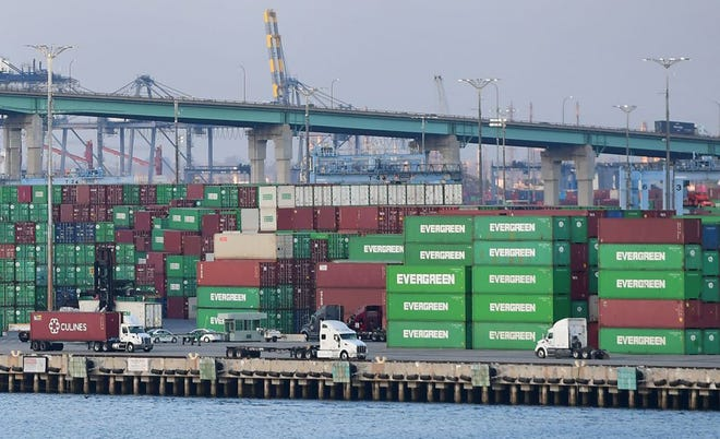 Containers stacked high are seen at the Port of Los Angeles on Sept. 28 in Los Angeles. Supply chain woes continue to be a drag on the U.S. economy.
