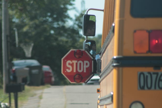 When a bus driver activates the amber/yellow warning lights on a bus, that means the bus will be stopping in 300 feet. State law requires motorists to stop when the stop sign is out and red lights on.