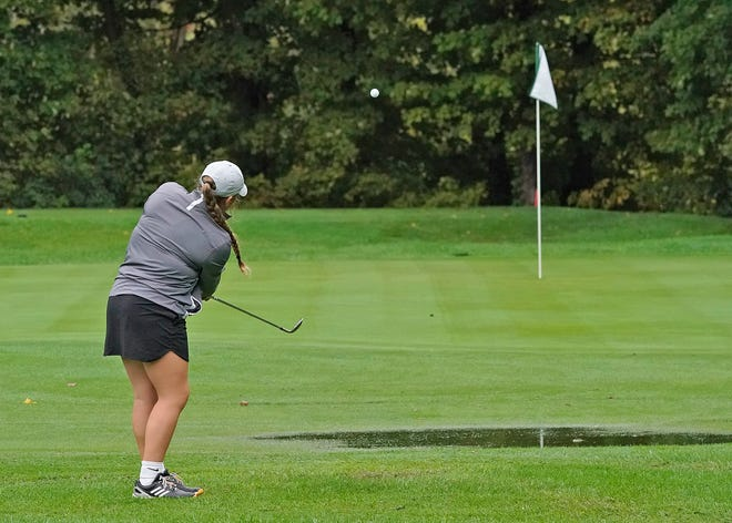 Clinton's Kyleigh Ramos chips over a puddle and onto the green at the Hills of Lenawee Monday during the Division 4 regional meet. [Telegram photo by Mike Dickie]