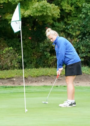 Lenawee Christian's Avery Sluss putts during Monday's Division 4 regional meet at the Hills of Lenawee. [Telegram photo by Mike Dickie]