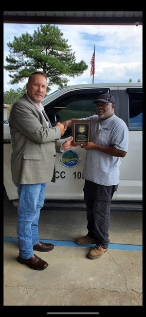 """District 1 Commissioner """"Boots"""" McCormick (left) presents Jerry Jackson with a plaque as part of his retirement from the county."""