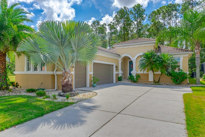 This beautiful and stylish concrete-block home is in the highly sought-after New Smyrna Beach community of Venetian Bay.