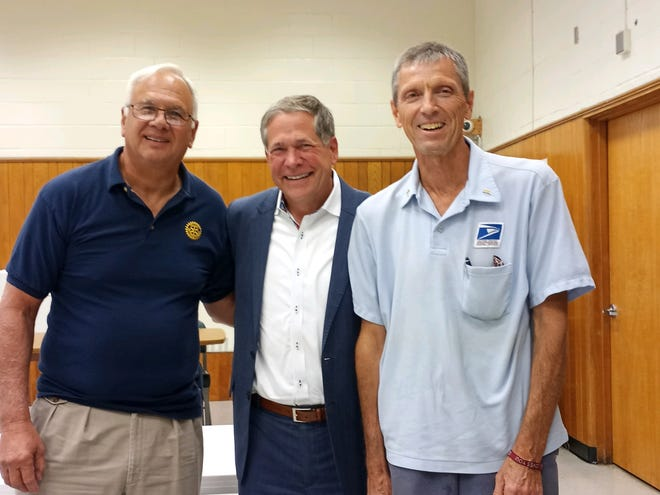 At left, Dave Mance, original owner and General Manager of WDNY, Doug Emblidge, center, and WDNY play by play announcer Frank Williams, who has worked at the station since day one.