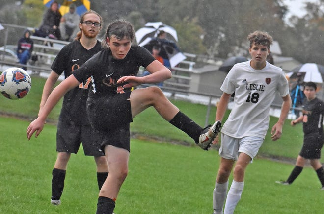 Quincy senior Nathan White looks to move the ball up the field while fellow senior Zachary Klimmer looks on Monday