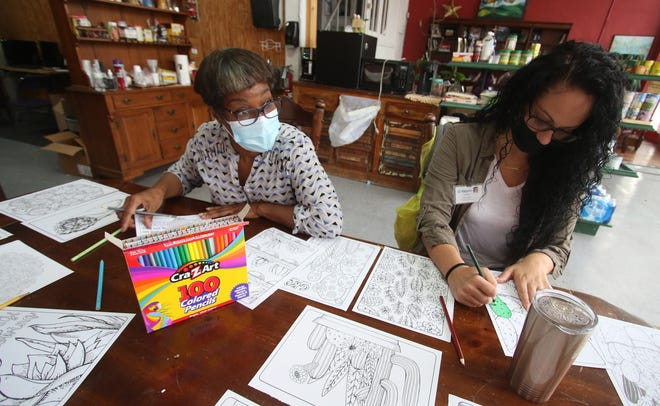 Maya Hector and Sandra Johnson make art at a free activity Tuesday morning, Oct. 5, 2021, at Trailhead Resources on West Warren Street in Shelby.
