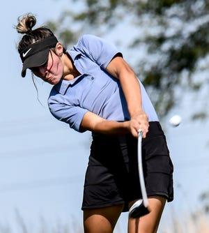 Garden City High School's Alli Sandoval drives a tee shot off Buffalo Dunes golf course's No. 10 in September during the GCHS girls golf invite.