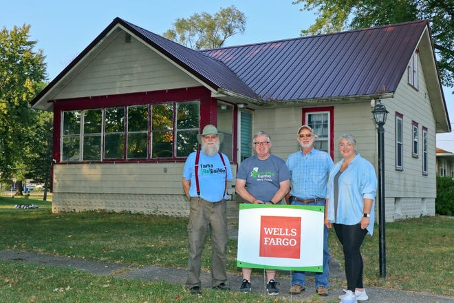 Rebuilding Together Henry County volunteers, in partnership with the Wells Fargo Builds program, will be completing home repairs to two Annawan homes on Saturday, Oct. 16. Representing RTHC are, from left, Dewey Richter, Paul Estes, Tom Newman, and Sarah Snyder.
