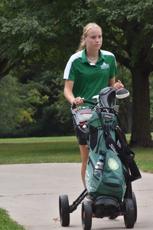 After holing out on the ninth green, Geneseo's Addie Mills heads to the 10th tee at Midland Golf Club near Kewanee on Monday morning, Oct. 4. Geneseo was competing as a team in the Class 1A sectional for a berth at state.