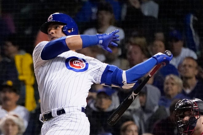 Chicago Cubs catcher Willson Contreras watches his home run off Minnesota Twins starting pitcher Griffin Jax during the third inning of a game on Tuesday, Sept. 21, in Chicago.
