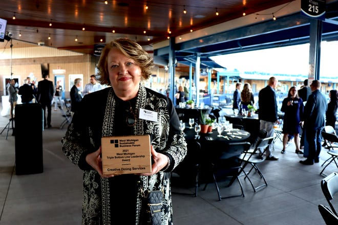 Creative Dining ServicesDirector of Sustainability Janine Oberstadt accepts the 2021 West Michigan Triple Bottom Line Leadership Award.