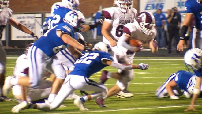 Ripley's Parker Boyd closes in to tackle Roane County's Briar Begler during a Friday night showdown at Memorial Stadium against the Raiders.