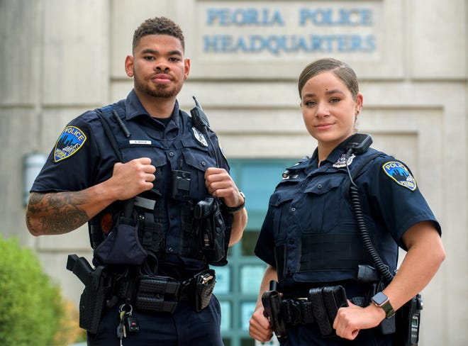 Nehemiah Doyle, left, 28, and Ciara Barker, 24,  both of Peoria, are two of Peoria's newest police recruits.