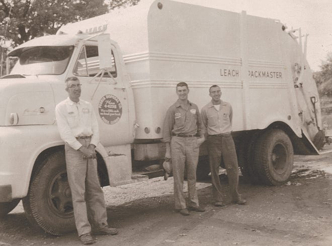 The second generation to run Peoria Disposal Company, Elmer, Reuben, Melvin Coulter stand in front of a garbage truck in the 1950s.