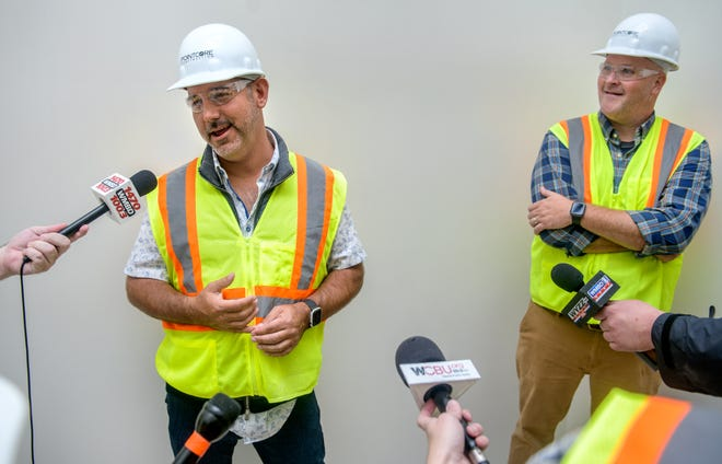 Peoria restaurateur Travis Mohlenbrink, left, and Craig Janssen, president of Central Illinois Doughboys, talk about their new ventures in the new OSF HealthCare headquarters under construction Tuesday, Oct. 5, 2021 in Downtown Peoria. Mohlenbrink is opening a 1950s Art Deco-style restaurant called Saffron Social, while Janssen is opening a Great Harvest Bread Company in the new building.
