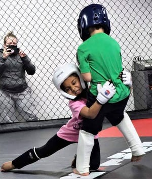 About two years ago Chris Rangel decided to try something new and different — he created a class at Ultimate Martial Arts for kids to learn Mixed Martial Arts.