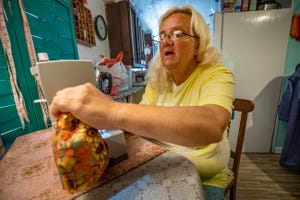 Beverly Marek , a resident of Gospel Village a non-profit that serves chronic homeless people makes fabric microwaveable bowl covers at her sewing station in her home in the village in Lakeland Fl. Monday Oct. 4  2021. Gospel Inc submitted and won a $5,000 prize in Florida Blue competition and qualified as finalist for $40K state prize. ERNST PETERS/ THE LEDGER