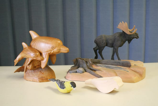 A display of art handcrafted by a member of the Woodcarvers Club.